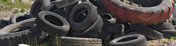 old tyres on waste land